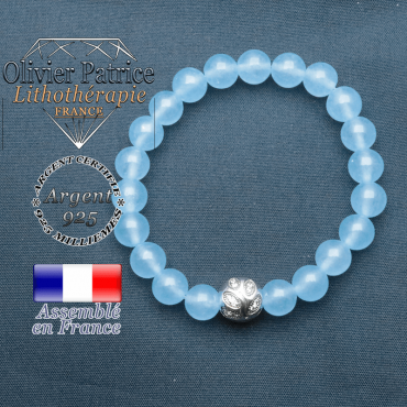 Bracelet surmonté de sa boule gravée de feuilles en argent 925 en pierre naturelle en agate bleu