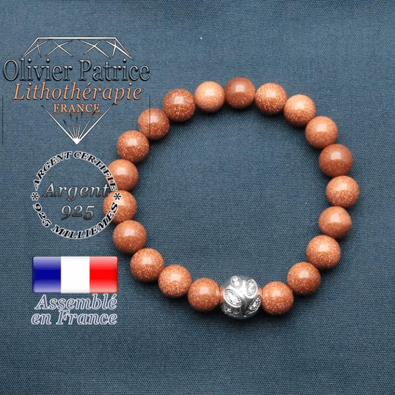 Bracelet surmonté de sa boule gravée de feuilles en argent 925 en pierre naturelle en goldstone