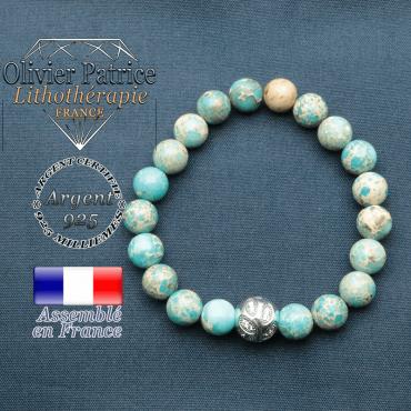 Bracelet surmonté de sa boule gravée de feuilles en argent 925 en pierre naturelle en agate dentelle