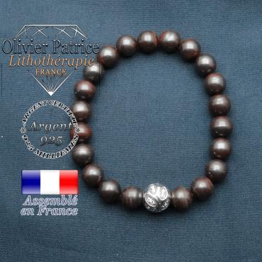 Bracelet surmonté de sa boule gravée de feuilles en argent 925 en pierre naturelle en oeil de fer