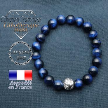 Bracelet surmonté de sa boule gravée de feuilles en argent 925 en pierre naturelle en oeil tigre bleu teinte