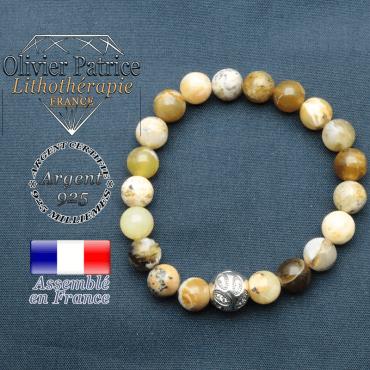 Bracelet surmonté de sa boule gravée de feuilles en argent 925 en pierre naturelle en opale jaune africaine