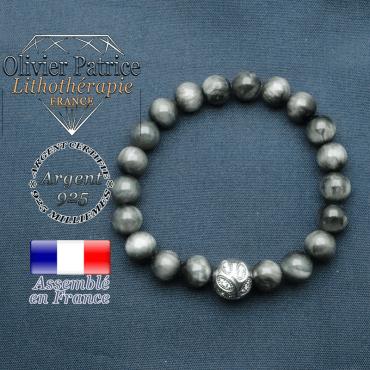 Bracelet surmonté de sa boule gravée de feuilles en argent 925 en pierre naturelle en oeil d'aigle