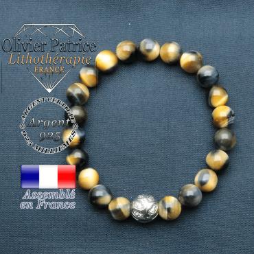 Bracelet surmonté de sa boule gravée de feuilles en argent 925 en pierre naturelle en oeil tigre bleu