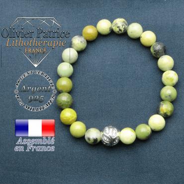 Bracelet surmonté de sa boule gravée de feuilles en argent 925 en pierre naturelle en turquoise africaine