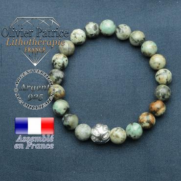 Bracelet surmonté de sa boule gravée de feuilles en argent 925 en pierre naturelle en turquoise bleue africaine