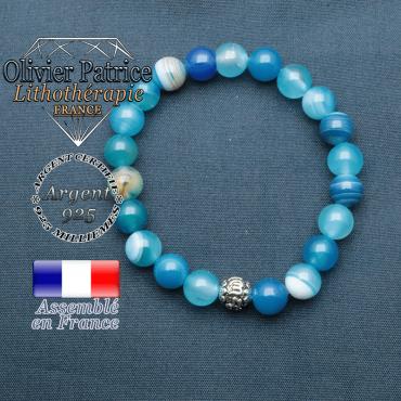 bracelet en pierre naturelle en agate bleu a bande et sa boule de finition om mani en argent 925