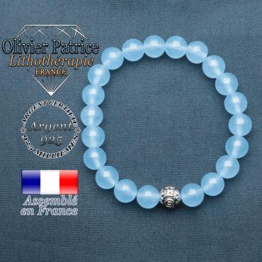 bracelet en pierre naturelle en agate bleu et sa boule de finition om mani en argent 925