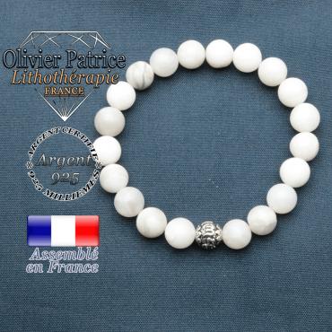 bracelet en pierre naturelle en agate grise et sa boule de finition om mani en argent 925