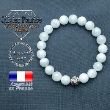 bracelet en pierre naturelle en aigue marine et sa boule de finition om mani en argent 925