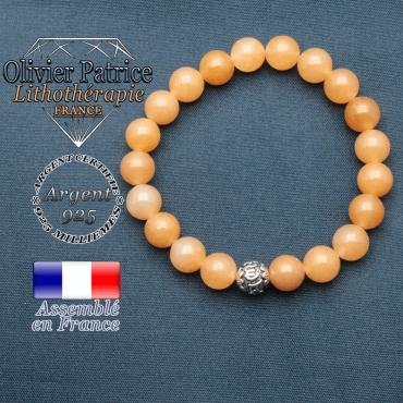 bracelet en pierre naturelle en aventurine orange et sa boule de finition om mani en argent 925