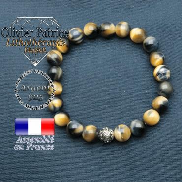 bracelet en pierre naturelle en oeil de faucon oeil tigre bleu et sa boule de finition om mani en argent plaqué
