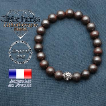 bracelet en pierre naturelle en oeil de fer et sa boule de finition om mani en argent plaqué
