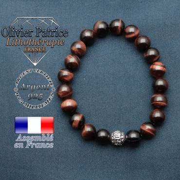 bracelet en pierre naturelle en oeil de taureau et sa boule de finition om mani en argent 925