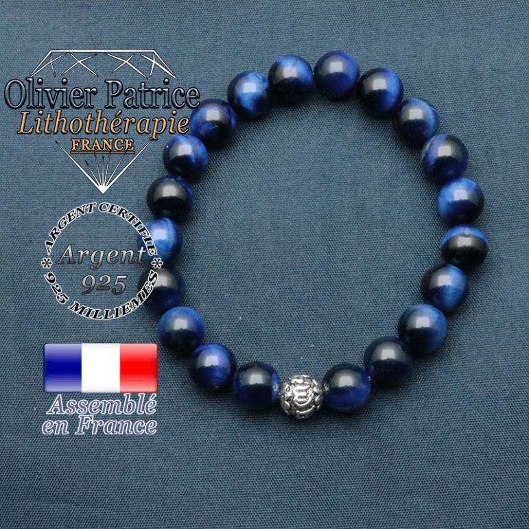 bracelet en pierre naturelle en oeil de tigre teinte bleu et sa boule de finition om mani en argent plaqué