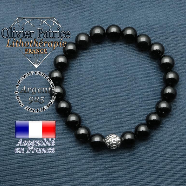 bracelet en pierre naturelle en onyx et sa boule de finition om mani en argent plaqué