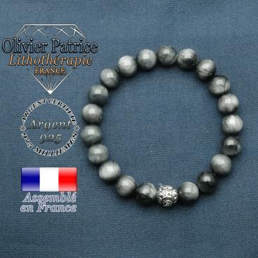 bracelet en pierre naturelle en oeil d'aigle et sa boule de finition om mani en argent 925