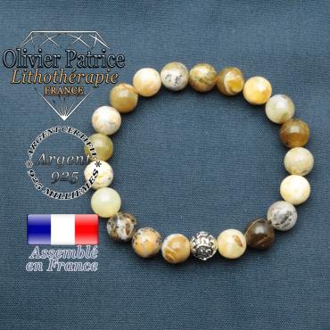 bracelet en pierre naturelle en opale jaune africaine et sa boule de finition om mani en argent plaqué
