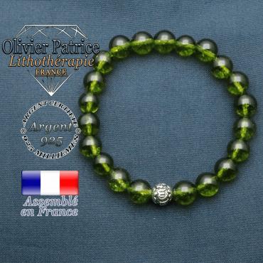 bracelet en pierre naturelle en peridot et sa boule de finition om mani en argent plaqué