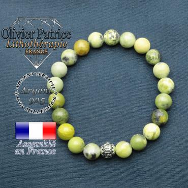 bracelet en pierre naturelle en turquoise africaine et sa boule de finition om mani en argent plaqué