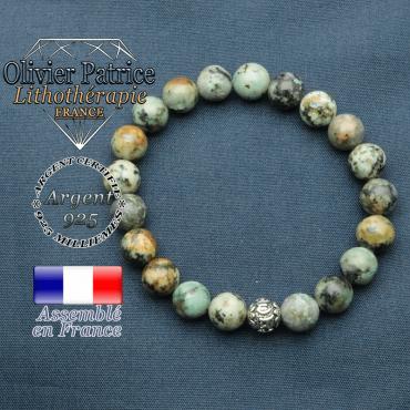 bracelet en pierre naturelle en turquoise bleu africaine et sa boule de finition om mani en argent plaqué