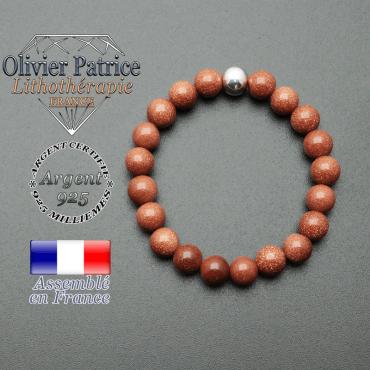 bracelet en pierre naturelle et sa finition boule lisse en argent 925 sa pierre est en goldstone