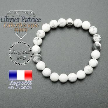 bracelet en pierre naturelle et sa finition boule lisse en argent 925 sa pierre est en howlite
