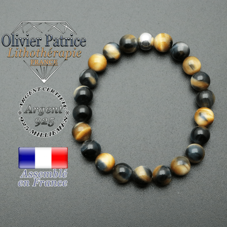 bracelet en pierre naturelle et sa finition boule lisse en argent 925 sa pierre est en oeil de faucon