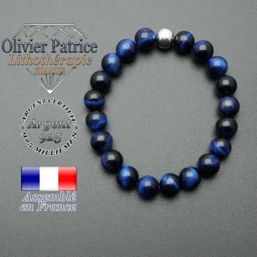 bracelet en pierre naturelle et sa finition boule lisse en argent 925 sa pierre est en oeil de tigre teinte bleue