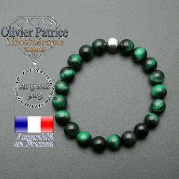 bracelet en pierre naturelle et sa finition boule lisse en argent 925 sa pierre est en oeil de tigre teinte vert