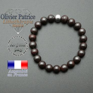 bracelet en pierre naturelle et sa finition boule lisse en argent 925 sa pierre est en oeil de fer
