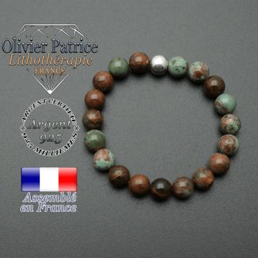 bracelet en pierre naturelle et sa finition boule lisse en argent 925 sa pierre est en opale verte africaine