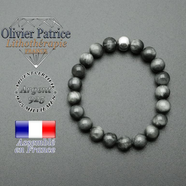 bracelet en pierre naturelle et sa finition boule lisse en argent 925 sa pierre est enpierre ou oeil d'aigle