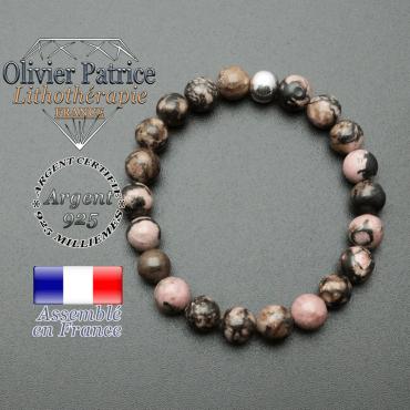 bracelet en pierre naturelle et sa finition boule lisse en argent 925 sa pierre est en rhodonite