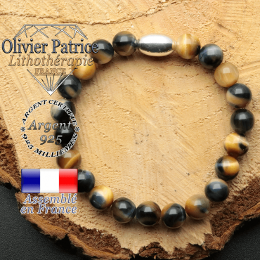 bracelet en pierre naturelle et son appret olive en argent 925 sa pierre est de l'oeil de faucon