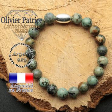 bracelet en pierre naturelle et son appret olive en argent 925 sa pierre est de la turquoise bleue africaine