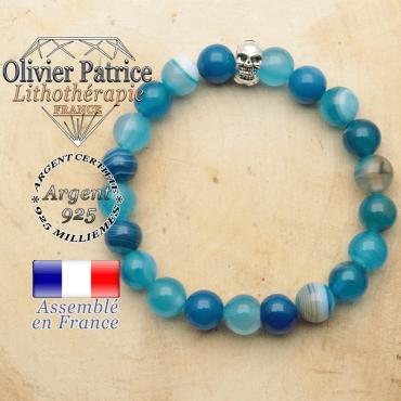 bracelet tete de mort avec sa pierre naturelle en agate bleue a bande