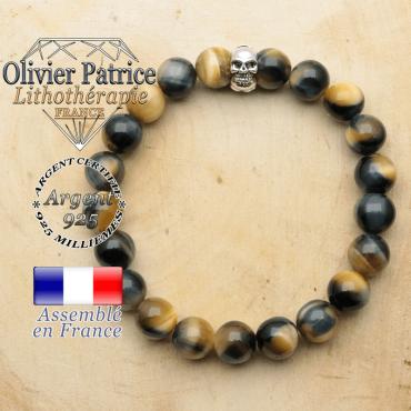 bracelet tete de mort avec sa pierre naturelle en oeil de faucon