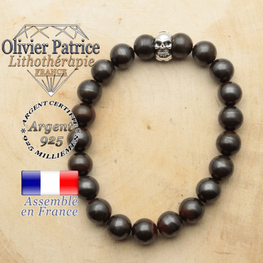 bracelet tete de mort avec sa pierre naturelle en oeil de fer