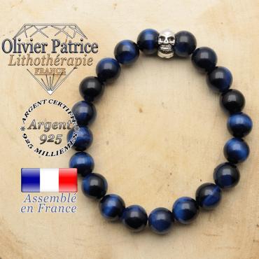 bracelet tete de mort avec sa pierre naturelle en oeil de tigre bleue