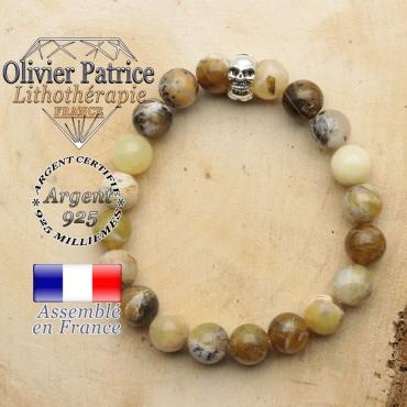 bracelet tete de mort avec sa pierre naturelle en opale jaune africaine