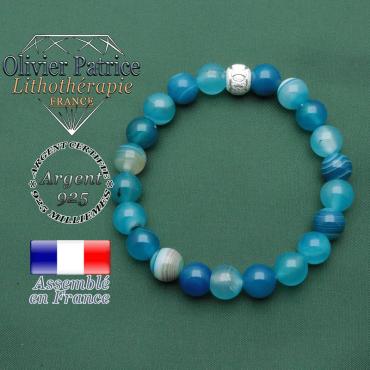 Votre bracelet agate bandes bleues avec sa finition brillantes avec un strass argent smiley sourire