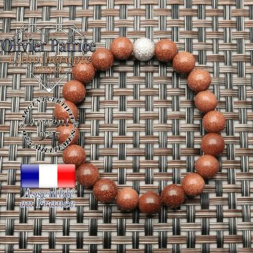 Magnifique bracelet brillant avec ses pierres de goldstone sablée et son appret strass uni de 8 mm