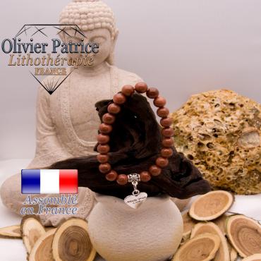 Bracelet goldstone et son charms coeur en alliage