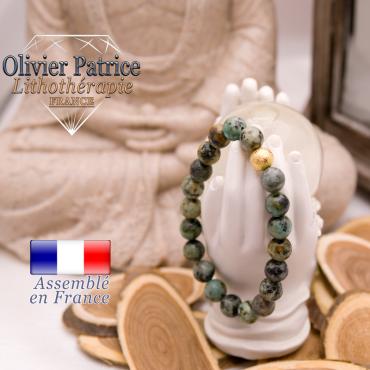Bracelet turquoise bleue africaine et sa boule plaqué or