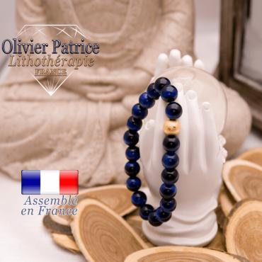 Bracelet Œil de Tigre teinte bleue et sa boule plaqué or