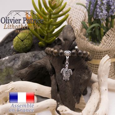Bracelet bronzite et son charms tortue en alliage