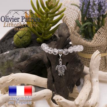 Bracelet cristal de roche et son charms tortue en alliage