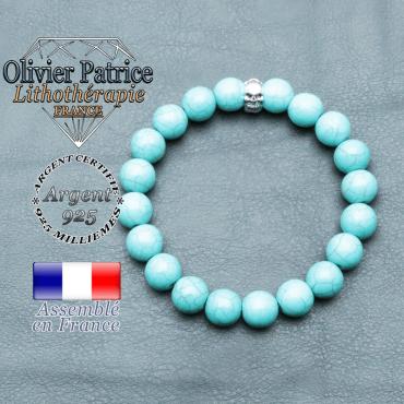 bracelet homme en pierre naturelle en turquoise de 10mm et sa tete de mort en argent 925 de 10mm