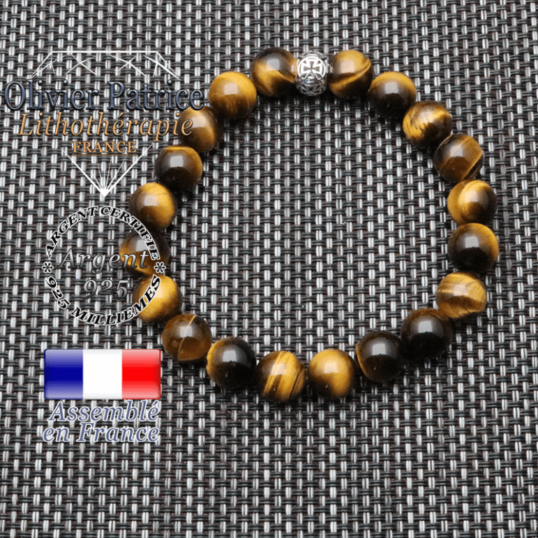 bracelet homme en pierre naturelle en oeil de tigre de 10mm et sa tete de mort en argent 925 de 10mm